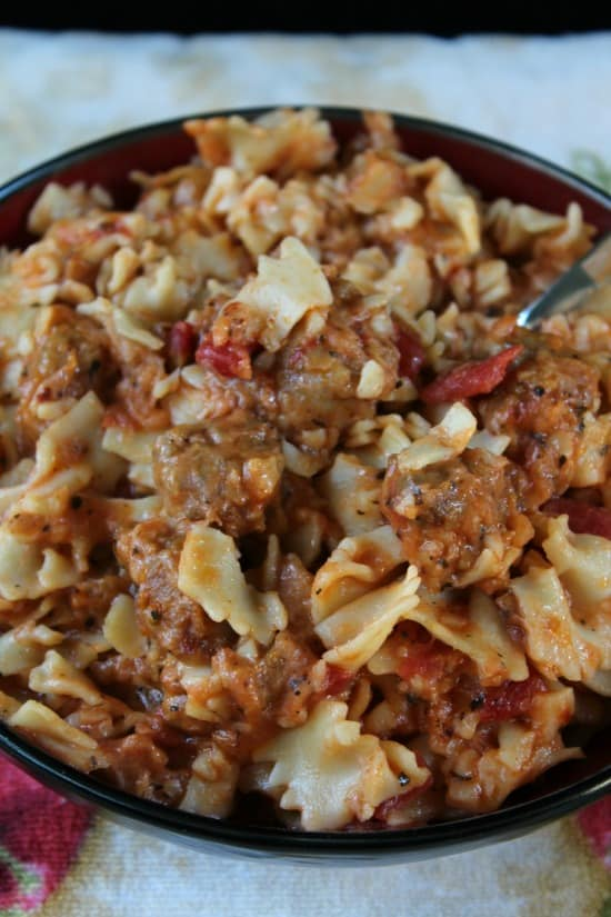 Farfalle with Sausage - a black bowl filled with the farfalle with sausage.