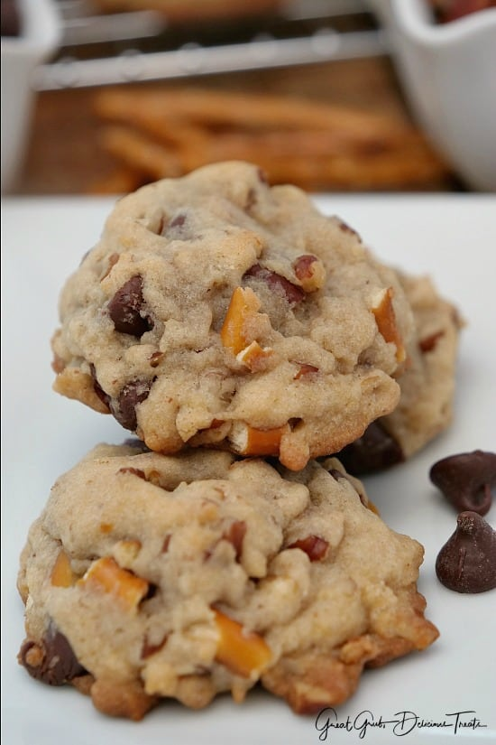 3 Chocolate Chip Pecan Pretzel Cookies sitting on a white plate