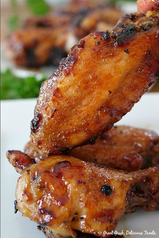 Honey Barbecue Chicken Wings are baked wings that are smothered in a delicious honey barbecue sauce. #chickenwings #honeybbqwings #appetizers #barbecuewings #greatgrubdelicioustreats