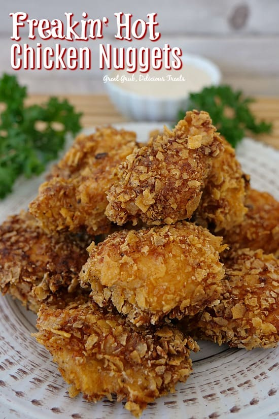 Freakin' Hot Chicken Nuggets are delicious and spicy! Coated in spicy, crushed corn tortilla chips, then fried. Super delish. #spicy #chicken #nuggets #appetizers #chickenfoodrecipes   #greatgrubdelicioustreats