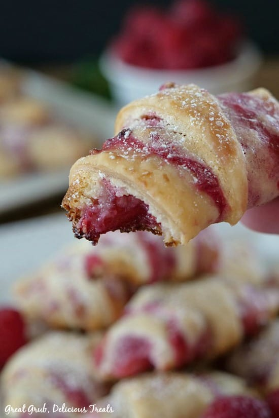 Raspberry Cream Cheese Bites are stuffed with a cheesecake filling with a raspberry sauce.