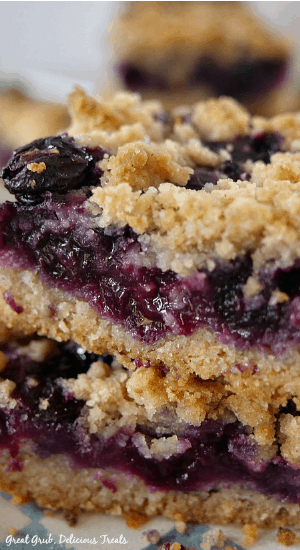 Blueberry Lemon Crumb Bars are bursting with fresh blueberries, lemon goodness, with a crumb topping and baked to perfection.