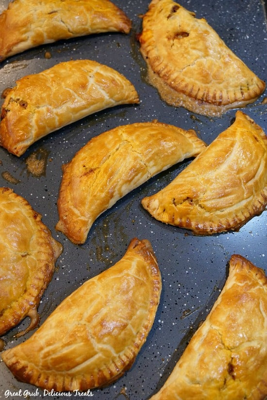 Baked Ground Beef Empanada are loaded with cheese and baked to a golden brown.