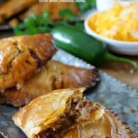 Cheesy Ground Beef Empanadas are loaded with seasoned ground beef, two types of cheese and then baked to perfection.