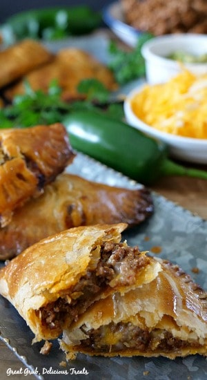 Cheesy Ground Beef Empanadas are  loaded with cheese, deliciously seasoned meat in a flaky crust.