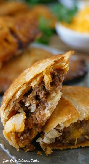 These Cheesy Ground Beef Empanadas are delicious, loaded with cheese, seasoned meat in a flaky crust.