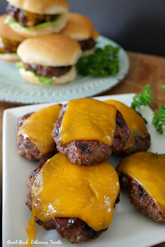 Grilled BBQ Meatloaf Sliders are small little meatloaf burgers grilled, topped with barbecue sauce and cheese.