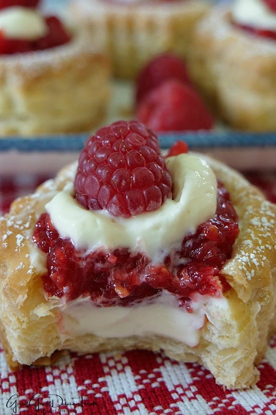 Raspberry Cream Cheese Pastries are filled with homemade raspberry sauce, cream cheese mixture and topped with a fresh raspberry.