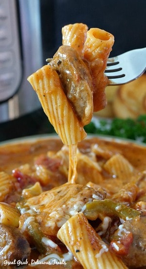 Instant Pot Italian Sausage Pasta is full of delicious flavor and is cheesy, loaded with Italian sausage and Rigatoni pasta.