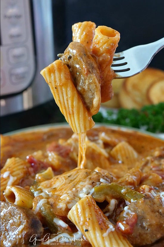 Instant Pot Italian Sausage Pasta is super cheesy, full of Italian sausage, Rigatoni pasta and a delicious sauce.