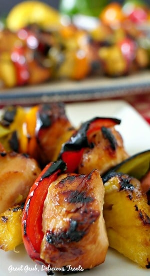 Grilled Teriyaki Chicken Kabobs are marinated chicken breasts pieces, fresh pineapple, bell peppers. on skewers then grilled.