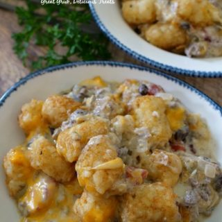 Mexican Tater Tot Casserole is loaded with ground beef, cheese, black beans, sour cream, tater tots.
