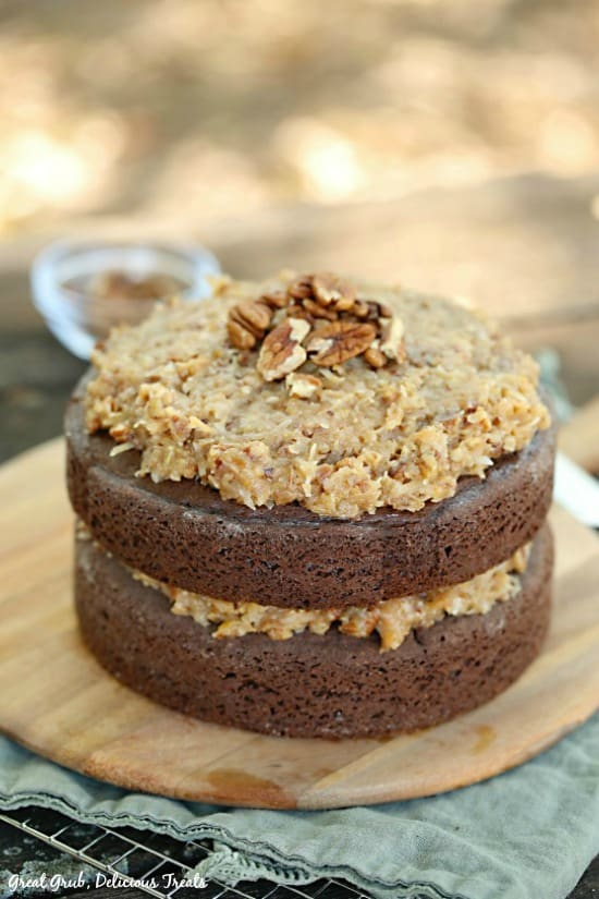 German Chocolate Cake is a two layered chocolate cake frosted with a classic coconut pecan frosting.