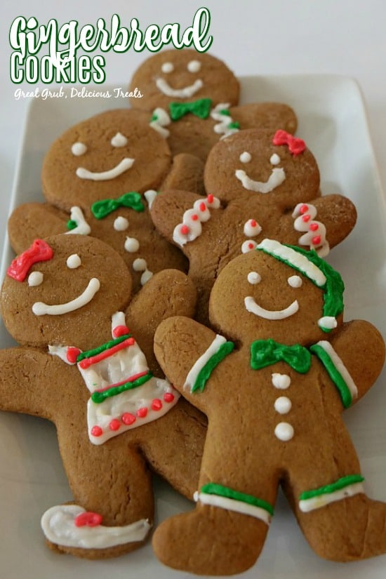 Gingerbread Cookies are decorated like boy and girl gingerbread cookies.