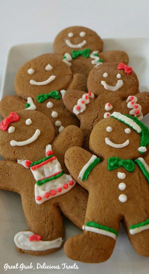 Decorated gingerbread people are decorated with white, red and green icing.