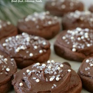 Chocolate Frosted Sugar Cookies are soft and chewy, frosted with chocolate frosting and sprinkles on top.