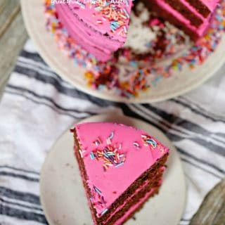 Chocolate Triple Layer Cake is 3 deliciously moist layers of cake, topped with pink buttercream frosting and candied sprinkles.