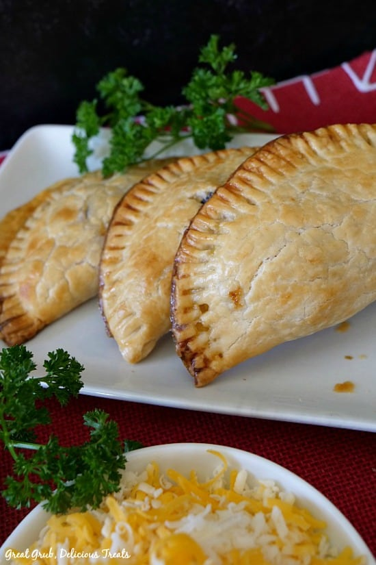 Rib Eye Breakfast Empanadas have beef, eggs, cheese, onions, tomatoes, seasonings.