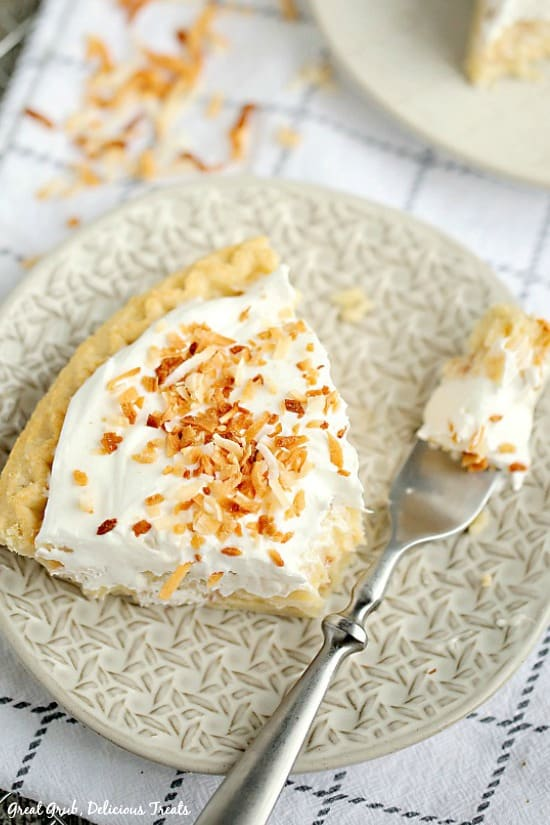 Coconut Cream Pie is a creamy coconut pie with a flaky crust, topped with cool whip and toasted coconut.