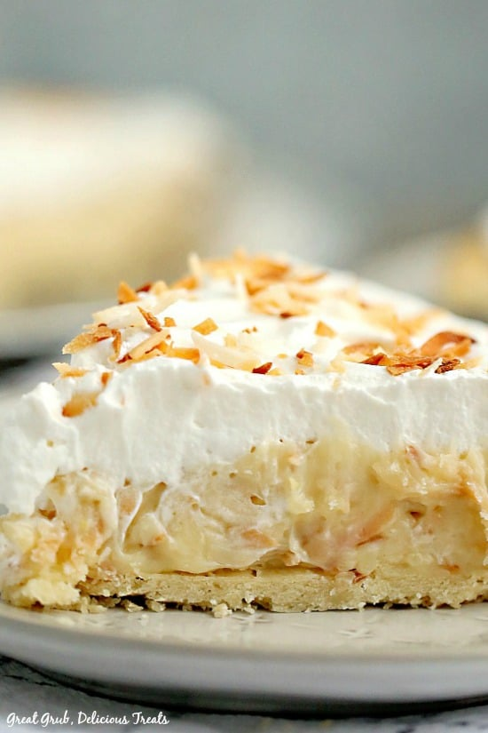 Coconut Cream Pie is a classic cream pie recipe loaded with a rich coconut cream filling and topped with toasted coconut.