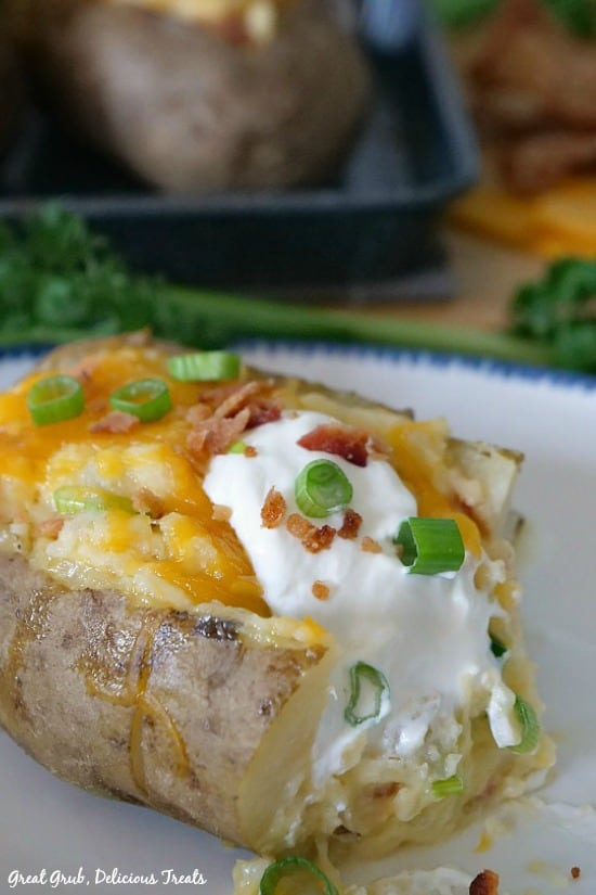 Loaded Twice Baked Potatoes are baked then baked again with mashed potatoes, cheese, bacon, sour cream and onions.