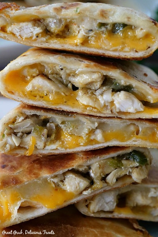Cheesy Chicken Quesadillas are fully loaded with seasoned chicken, cheddar cheese and Monterey Jack cheese, then fried to a golden brown.