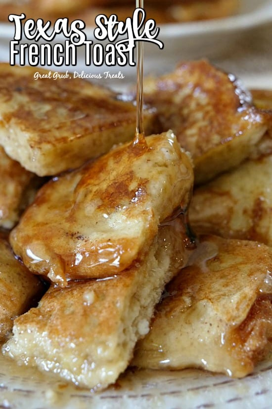 French Toast cut up with maple syrup being drizzled over them.
