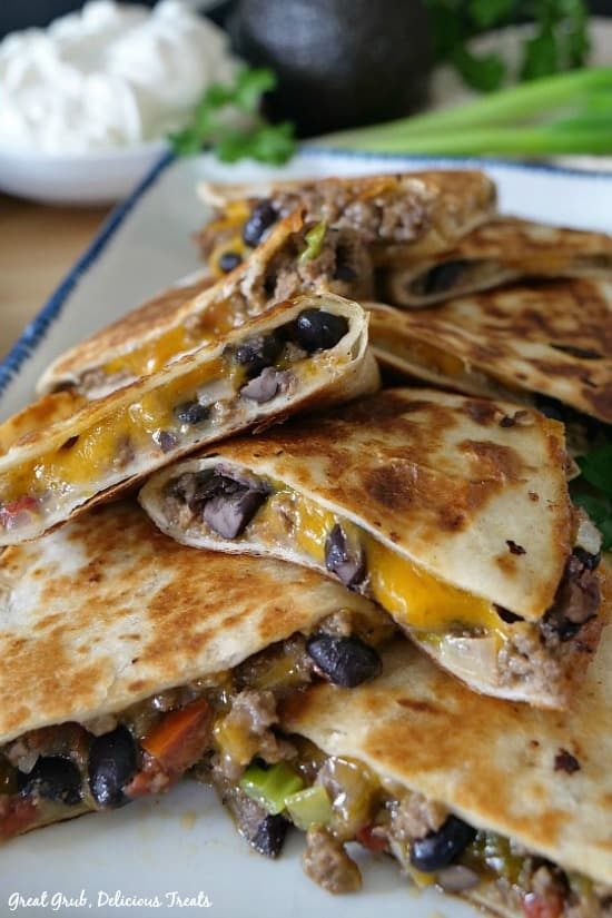 Ground Beef Quesadillas are filled with ground beef, black beans, two types of cheese and fried to a golden brown.