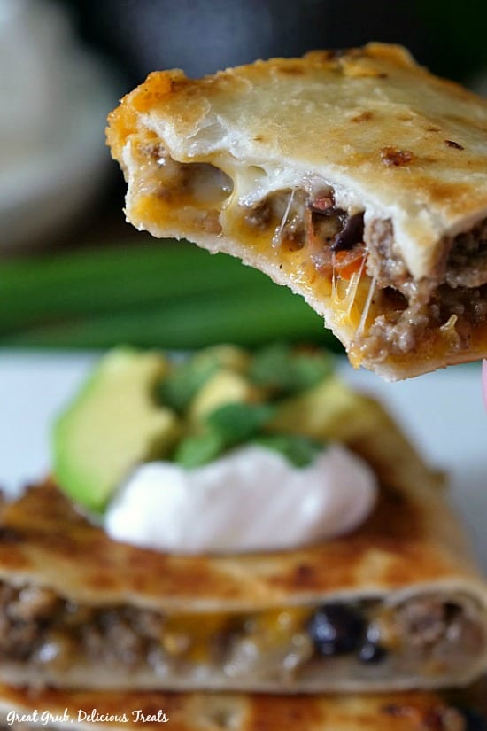Ground Beef Quesadillas are fried flour tortillas loaded with hamburger, black beans, cheese and more.