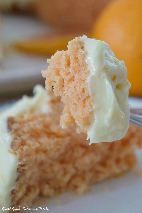 A bite of Orange Bundt Cake on a fork.