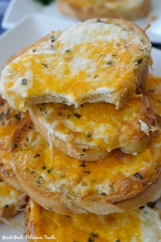 Garlic Cheese Bread shows 4 to 5 pieces of cheesy garlic bread sitting on top of each other.