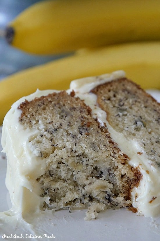Banana Cake with Cream Cheese Frosting is a moist piece of cake frosted with cream cheese frosting.
