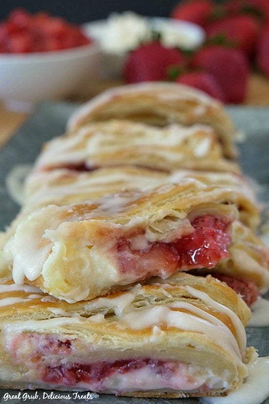 Strawberry Cream Cheese Danish slices on a grey tray.