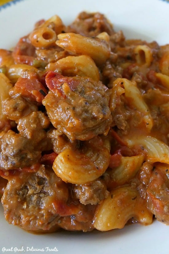 Cheesy Italian Sausage Pasta is a picture of a bowl full of pasta with noodles and sausage.