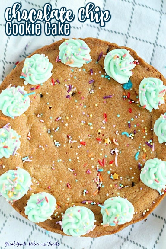 Giant chocolate chip cookie with rainbow sprinkles and dollops of frosting