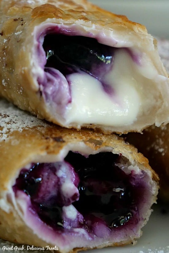 Blueberry Cream Cheese Egg Rolls - a picture of two eggs rolls on laying on top of each other showing the blueberry and cream cheese filling.