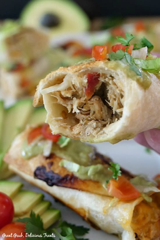 Spicy Chicken Flautas - a picture of a chicken flauta that shows the inside chicken mixture.