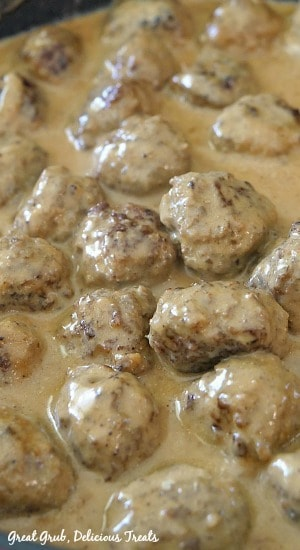 A photo of Swedish Meatballs and gravy in a skillet as they are cooking.