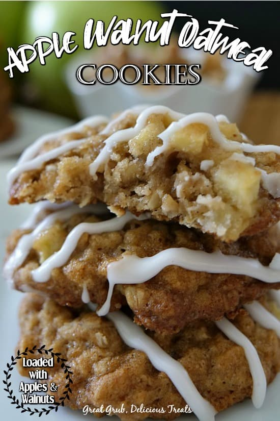Apple Walnut Oatmeal Cookies - three cookies stacked on top of each other drizzled with glaze and apples in the background.