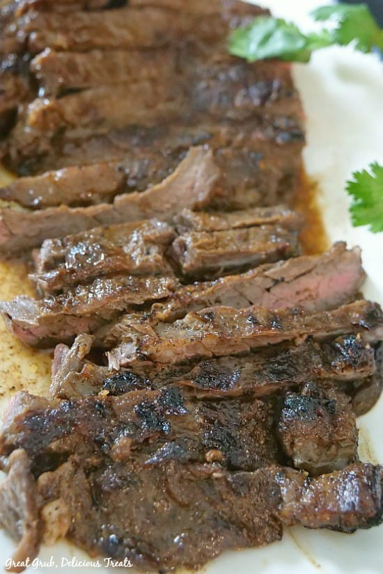 Beef Fajitas - a photo of beef fajita meat sliced against the grain, laying on a white plate.