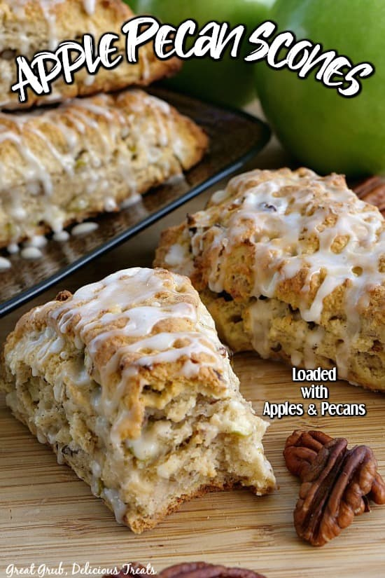 Apple Pecan Scones - a plate of scones with two scones sitting on a cutting board with a bite taken out of one with pecans and green apples in the background.