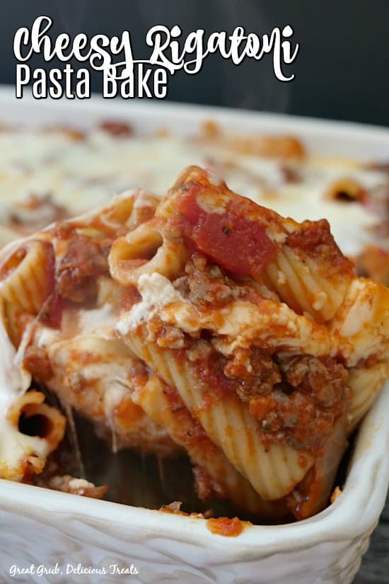 Cheesy Rigatoni Pasta Bake in a white casserole dish with the title at the top left corner.