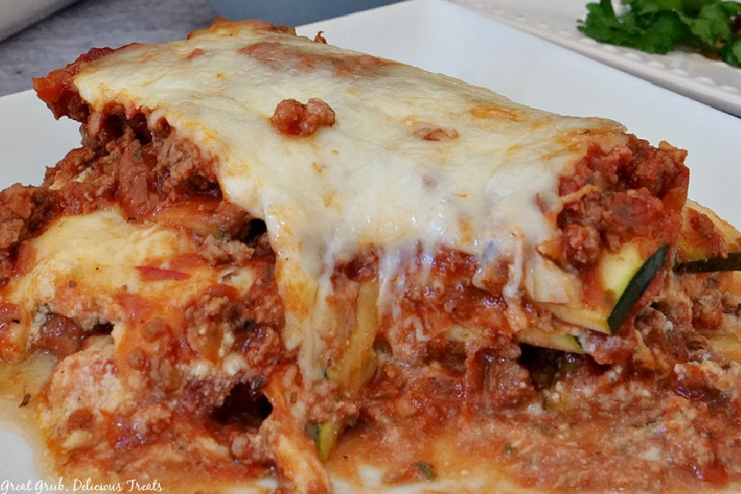 A white plate with a serving of zucchini lasagna.