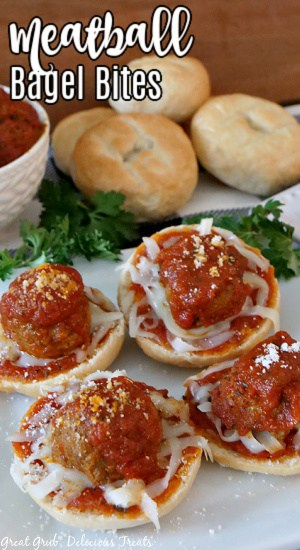 Four Meatball Bagel Bites on a white plate with parsley in the background, a white bowl filled with cooked meatballs in tomato sauce, and a white plate with stacked plain bagels, with the title in the top left corner.