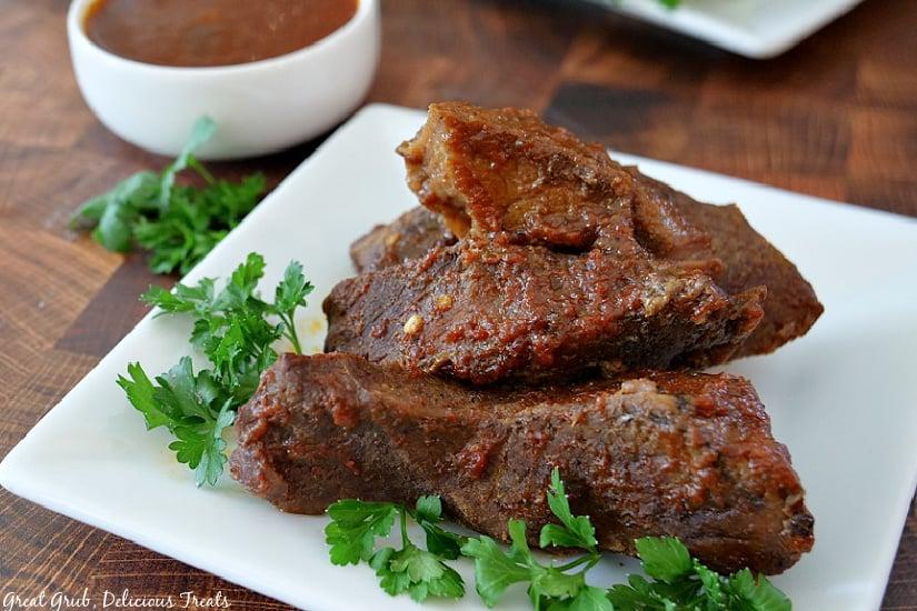 4 Crock Pot Texas Style Boneless Beef Ribs on a white plate.