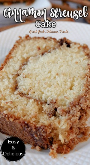 A slice of cinnamon streusel cake on a white plate.