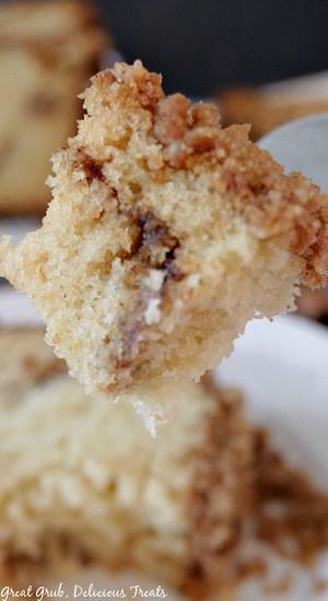 A forkful bite of cinnamon streusel cake.