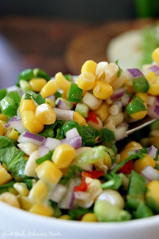 A white bowl filled with southwest corn salsa.