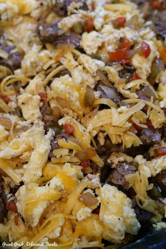 Beef Fajita Breakfast Burritos - beef and egg mixture after adding shredded cheese.