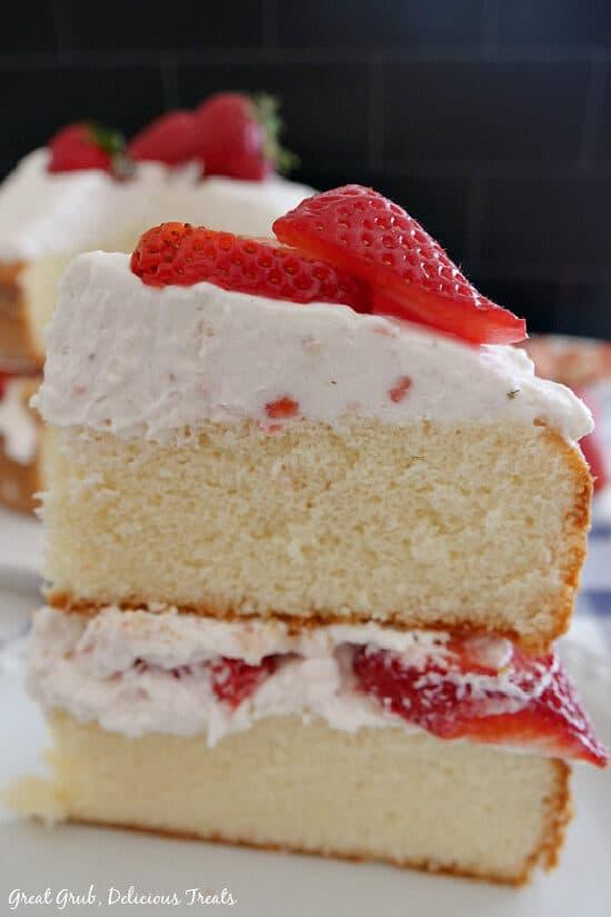 A close up photo of a slice of strawberry shortcake cake.